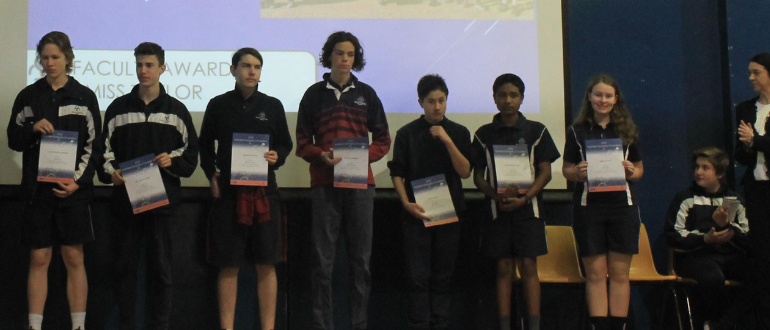 Students on stage with certificates